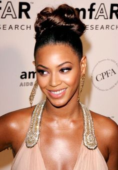 Beyonce's Greatest Hairstyles: 31 Ideas for Curly, Textured Hair: Lipstick.comUpdos Twist two-inch pieces into coils, and fasten with bobbies.