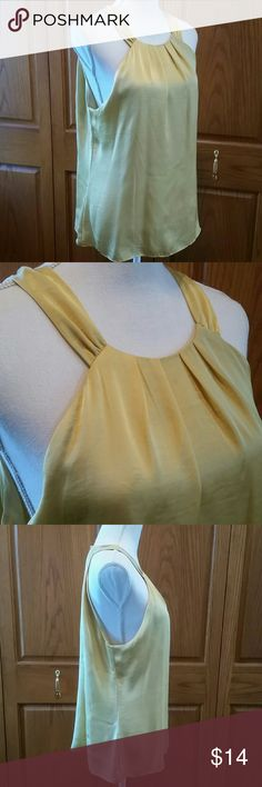 Violet and Claire Gold Sleeveless Blouse 100 % polyester. Keyhole back neck, pleated front collar line, sold and flowing. Extra lining in the front breast area. A staple for any closet. Breastline across laying flat measures 20.5 inches. 26 in length. Gently worn a few times, in excellent condition. Violet & Claire Tops Blouses