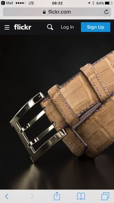 Spectacular nubuck crocodile belt rise on a palladium shiny buckle