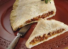 Zoned-Out Calzones Recipe - Zone in on your own calzones. Beef and cheese are baked inside a tender crust made with Bisquick® mix.
