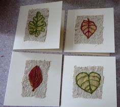 Free machined leaves mounted on handmade paper.