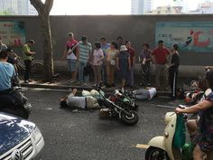 Shanghai: Accident victims? Hurt? in Pain? Dying? No, on the phone!