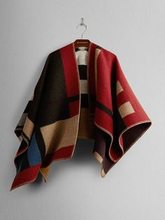 The perfect outerwear that doubles as an in-flight blanket. // Burberry Colour Block Check Blanket Poncho