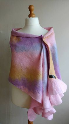 Check out this item in my Etsy shop https://www.etsy.com/uk/listing/399928505/felted-wrap-nuno-felt-ruffle-shawl