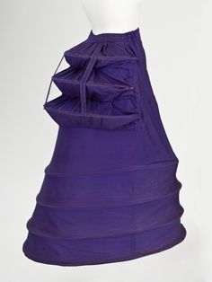 Cage Crinolette The Los Angeles County Museum of ArtWoman's Cage Crinolette Petticoat England, Costumes; underwear (lower body) Cotton and wool twill with steel Center back length: 35 in. Diameter: 25 in. 1870s Fashion, Edwardian Fashion, Vintage Fashion, Gothic Fashion, Moda Vintage, Vintage Mode, Vintage Outfits, Vintage Dresses, Floral Dresses