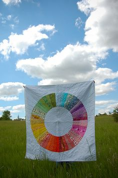 love the quilt and the frame around it! what a beautiful sky and field!