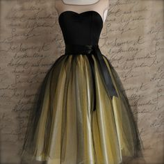two layers of canary yellow tulle topped with two layers of jet black tulle. The waist is black satin for a fun witch costume