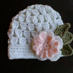 Ravelry: Baby Beanie with Flower (cluster) pattern by Lisa Auch (free)