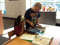 Using iPads in the library.