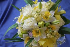 Bridal Bouquet created at Gene's Floral, Beaver Dam Wisconsin. White roses, Daffodils, yellow stock