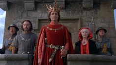 Chris Sarandon as Prince Humperdinck (center), Christopher Guest as Count Tyrone Rugen (left of the Prince, the six fingered vizier, and Anne Dyson as The Queen, accompanied by two unknown guards princess-bride-1.jpg (JPEG Image, 1832×1032 pixels) - Scaled (93%)