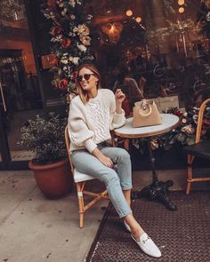 Cream cable knit sweater with light wash skinny jeans and white #Gucci mule loafers outfit - Charlotte Bridgeman