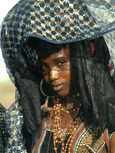 Wodaabe girl.  I love their jewelry.  They use whatever they can find or trade on their travels and then make beautiful adornments with it.  Always amazing!