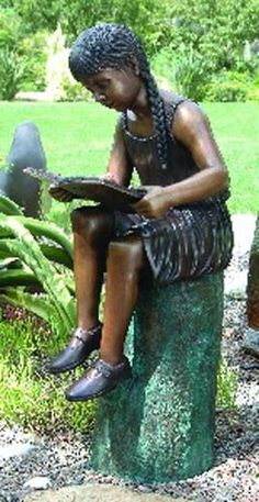 Emily's Secret Retreat Solid Bronze Garden Statue -- When you see the life-sized, solid bronze sculpture depicting Emily peacefully reading her book in your garden, you just might do a double take! Each piece of the playful girl sculpture is cast in the traditional lost wax method, which guarantees lasting beauty and highlights. This is a bronze sculpture, reminiscent of the finest Victorian garden art!