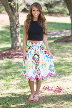 You're bound to make a bold statement with this skirt! It's perfect for weekend date nights - the vibrant colors will really stand out from the crowd! This skirt features a geometric aztec-style pattern with gold, black, and off-white alongside neon shades of pink, blue, and green. This skirt flares out from the waist, is slightly pleated, and has a zipper on the side.