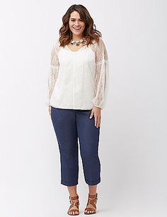 Sheer peasant top breathes romance into your wardrobe with all-over lace for ultra-feminine layering. Flattering V-neck and long sleeves with ruffle trim. Layering piece sold separately.  lanebryant.com