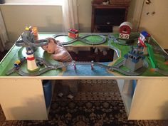 Train table made with Ikea storage with hole cut in for optimal play space My son has been playing in it nonstop which is why he looks so tuckered out by darcrista via F. Lego Storage, Ikea Storage, Storage Spaces, Storage Ideas, Train Table, Lego Trains, Lego Room, Play Table, Wooden Train