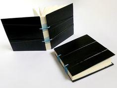 from Canteiro De Alfaces artist books in black and blue with interesting spine stitch variation on the caterpillar stitch - livros artesanais: livros artesanais