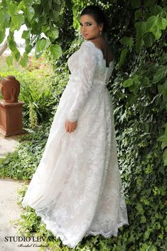 Plus size lace a line wedding gown with long sleeves. Sophia. Studio Levana