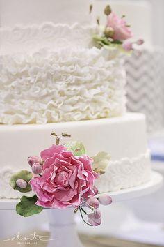 The SweetSide white on white ruffled wedding cake  Photo: Alante Photography