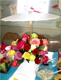 Baby Shower Centerpieces: White Vases with Flower Arrangements with Small Oriental Umbrellas <3