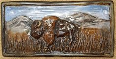 "Buffalo ceramic wall tile, handmade. Buffalo with mountains.  4"" x 8"". Ceramic tile art. Bathroom tiles, kitchen tiles, fireplace tiles, etc"
