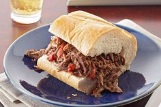 Roasted peppers and slow simmering are the keys to a shredded beef sammy that rivals the hot, delicious fare of a big-city deli.
