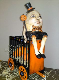 Featured in ADQ Magazine, The Egg Man. Humpty Dumpty, OOAK Halloween art doll, Circus Wagon, Pumpkins, paper mache
