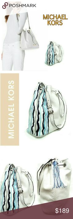 """MICHAEL KORS WHITE JULES DRAWSTRING BAG   NWOT UNIQUE MICHAEL KORS LARGE JULES DRAWSTRING BAG  I brought this new bag to the Michael KORS store in St John's Town Center & its painted by an artist, no name, but it is new & authentic! Beautiful SHOW STOPPER! *   Optic White Venus Leather *.  Adjustable Shoulder Strap; 13 1/3"""" Drop *.  Drawstring Top *.  Inside, Monogram Lining, Open & Zip Pockets *.  11""""H X 11 1/2""""W  X 4 1/2""""D If you're looking for something UNIQUE...this is it! Michael Kors…"""