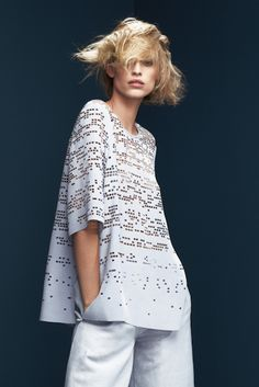 Heavy silk crepe t-shirt with custom laser cut pattern and laser cut edges.