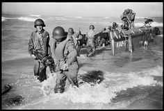 45th Infantry Division soldiers offloading onto Licata Beach, Invasion Day, July 11, 1943.