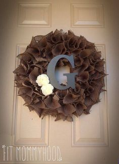 Burlap wreath Get the full how to at  |www.fb.com/fitmommyhood|  What you will need:  Medium size foam wreath  Scissors  Hot glue gun- make sure you get the low temp one so it doesn't melt the Styrofoam  Screw driver- to poke holes in the wreath  Burlap- 3 yards   Embellishments