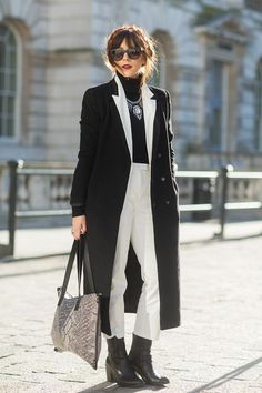 Shop this look for $295:  http://lookastic.com/women/looks/turtleneck-and-statement-necklace-and-overcoat-and-skinny-pants-and-shopper-handbag-and-ankle-boots/1264  — Black Turtleneck  — Silver Statement Necklace  — Black and White Overcoat  — White Skinny Pants  — Grey Print Shopper Handbag  — Black Leather Ankle Boots