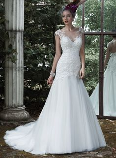 Evianna - by Maggie Sottero. Really love this too! Especially the back!