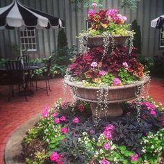 From the @mackenziechilds courtyard, steal this idea for a fountain-turned-planter. Love all those layers of #color!  —#BHGTakeover @kjkiick