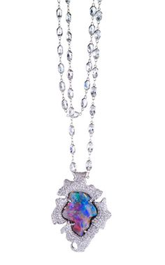 Lily pendant necklace in 18k gold with 19.26 ct. Lightning Ridge Black Opal, 4.5 cts. t.w. diamonds, on an 18k gold and white topaz chain, $60,000; Katherine Jetter at Couture booth No. 315