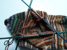 """Helical socks: jogless stripes and using up sock yarn leftovers. includes the advice don't jump into helical right from the toe-up cast on """"unless you have a large vocabulary of expletives"""" I like her style :)"""