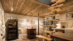 Wonderful 30 Basement Remodeling Ideas + Inspiration in Modern Concept : Wine Cellar Wooden Ceiling Modern Stairs Stony Wall