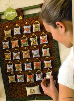 Cross Stitch - Advent Calendar Wall Hanging - Stitched December 2012.  This is how it should look when all the machining is finished but mine's not completed yet.