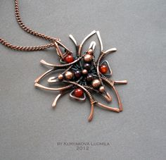 Pendant of copper wire made by hand decorated with beads - garnet, agate, copper