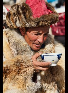 Kazakh eagle hunter drinking milk tea in the Altai Region of Bayan-Ölgii in Western Mongolia by jitenshaman, via Flickr