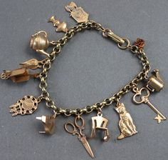 Antique Charm Bracelet / 13 Charms.