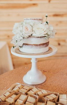 light pink cake lined with white roses