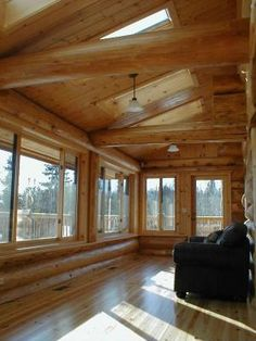 A three season porch on a scribed Western Red cedar log home. http://www.huismanconcepts.com/
