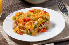 Studded with whole wheat bread, onion and colorful peppers, this better-for-you cheesy egg casserole whips your morning into a little fiesta.