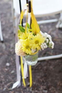 Pretty wedding ceremony flowers...