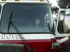 """Carly """"drives"""" the fire engine."""