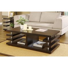 This architecturally inspired design coffee table features a uniquely detailed design with multi-shelving units. The table also has a nicely chosen dark espresso finish, with silver finish cylidrical accent supports.