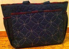 Knitting bag in machine emroderied pebbles and hand sewn sashiko patterns.
