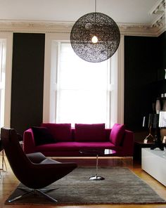 Love the fuchsia pink sofa for the open plan living area!